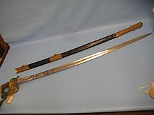 Victorian Naval Officer's sword with knot and brass mounted leather scabbard