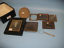 Three Victorian Daguerrotypes, four various frames and a silver handled magnifying glass