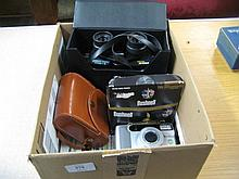 Cased pair of Tasco binoculars, two other pairs of binoculars and a Konica camera