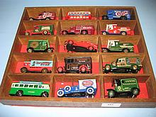 Collection of fifteen diecast model advertising vehicles in a wooden presentation display box
