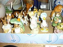 Beswick figure of an owl, two figures of hounds, eight Beswick Beatrix Potter figures (with brown stamps), Royal Albert figure of Peter Rabbit (a/f) and a Royal Doulton figure of ' Dusty Dog Wood '