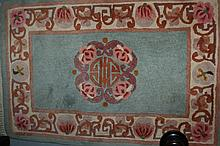 Group of three small Chinese floral decorated rugs