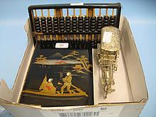 Japanese papier mache lacquered photograph album, wooden abacus and a metal figure of a horse and carriage