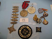 St. Johns Ambulance Brigade Coronation 1911 medal awarded to Nurse Sister Emily M. Carrington with red and blue ribbon and bar with a silver medallion and seven bars for 1908, 1910 to 1915, No. 104352, two cloth badges and various National Savings