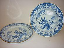 Pair of 18th Century Chinese blue and white plates decorated with lake scenes and water fowl