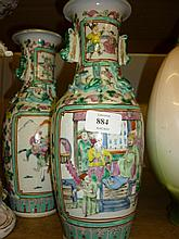 Pair of small 19th Century Canton baluster form vases decorated with panels of figures, 11.25ins high