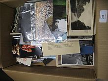 Box containing various postcards and ephemera