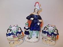 19th Century Staffordshire figure with a child together with a pair of similar Highland figure groups