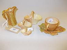 Royal Worcester Foliage pattern cup and saucer, graduated set of three blush ivory baskets and a leaf form jug (some damages)