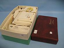 Box containing a small quantity of various First Day covers and an album containing a quantity of stamp related postcards
