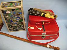 Coloured leaded glass light box, '50's red travel case, spelter figure of a lady and a hardwood walking stick
