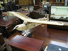 Large wooden model of a propeller driven monoplane