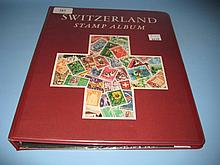 Album containing a collection of Switzerland stamps