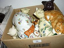 Box containing a quantity of miscellaneous porcelain and pottery figures of cats