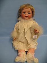 Koppelsdorf German bisque headed doll with jointed body, the head marked A9M with sleeping eyes