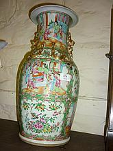 19th Century Canton famille rose baluster form vase painted with panels of figures and flowers and with gilded dog of foe and serpent mounts and side handles, 20ins high approximately