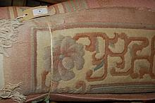 Chinese washed carpet with typical floral design on a pink ground with borders, 9ft x 6ft