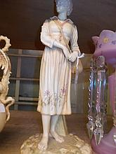 Large Hadley Worcester blush ivory figure of a standing girl carrying a wicker basket, 16.5ins high