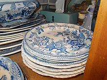 Group of four 19th Century stone china blue and white transfer printed soup dishes decorated with India Temple pattern together with a set of four plates decorated India Flowers pattern
