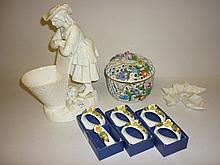 19th Century Minton white glazed figure of a girl leaning on a basket (a/f), a Coalport floral encrusted dish (a/f), modern Dresden pot pourri vase and cover, six Aynsley napkin rings and a Worcester dish in the form of a maple leaf