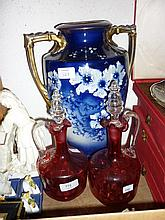 Pair of Victorian cranberry glass decanters with stoppers