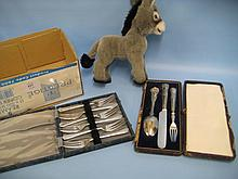Modern Steiff soft toy in the form of a donkey together with a cased set of cake forks and a Christening set