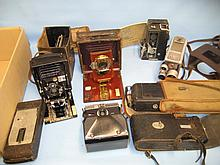 Small leather cased plate camera, two bellows cameras and others