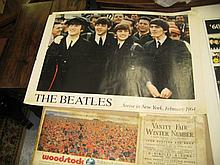 Folio containing a collection of various advertising posters including: Beatles, the Who and others and a Vanity Fair magazine