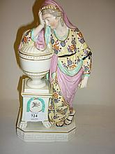 Derby style hard paste porcelain figure of a classical maiden standing beside an urn (some damages)