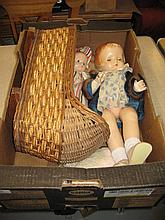 Two 1930's composition dolls by Effanbee, Patsy Ann and Patsy, together with miscellaneous clothing and a cane work cradle (some damages and losses)