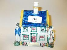 19th Century Pratt type money box in the form of figures standing beside a cottage (slight damages and restorations)