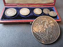 Three Victorian maundy coins, two Georgian maundy coins in an 1867 case together with a Victorian crown 1892