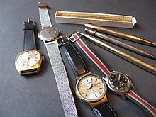 Jaquet Girard, gentlemans stainless steel automatic wristwatch with calendar aperture, together with three other gentlemans wristwatches, a silver propelling pencil and three gold plated propelling pencils