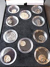 Boxed collection of yellow and white metal Celtic type coins