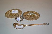 London silver Apostle handled spoon, two embossed and pierced dishes and a small shell form salt