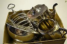 Two plated toast racks, teapot and sugar bowl, miscellaneous flatware and other silver plate