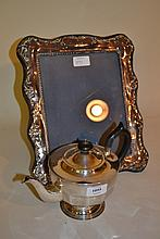 20th Century Sheffield teapot of circular faceted design together with a modern silver photograph frame (a/f)