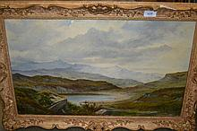 19th Century oil on canvas, figures before a Highland lake with distant mountains, indistinctly signed, housed in a swept gilt frame, 16ins x 29ins
