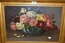 Oil on canvas, still life, roses in a jardiniere, housed in a gilt frame, signed, 20ins x 26ins