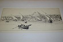 W.L. Wyllie, pair of signed etchings, view on the Nile with dhows before pyramids and Naval shipping in a North African port, both signed (one with slight discolouration to the paper)