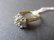 18ct Gold seven stone diamond cluster ring