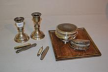 Small rectangular silver photograph frame (a/f), pair of silver dwarf candlesticks, two trinket boxes and four pocket knives