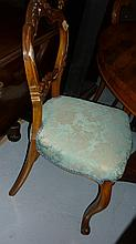 Set of four Victorian carved walnut balloon back dining chairs