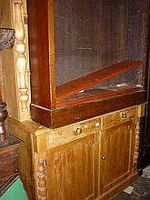 Polished pine dresser, the moulded cornice above a boarded shelf back, the base with two drawers above arched doors on a plinth base