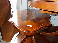 Shaped oval floral inlaid coffee table on carved splayed quadruped base