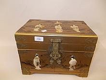 20th Century Chinese gilt lacquer table cabinet with hinged cover and two panelled doors