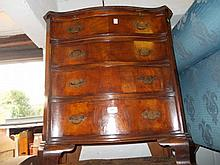 Reproduction mahogany serpentine fronted four drawer chest on bracket supports