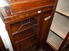Early 20th Century mahogany bookcase with bar glazed and panelled door raised on low cabriole supports