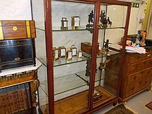 Early 20th Century mahogany two door shop display cabinet with glass shelves, raised on square tapering supports