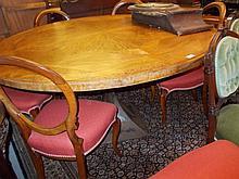 Circular Italian burr wood segmented veneered table on faceted waisted iron base